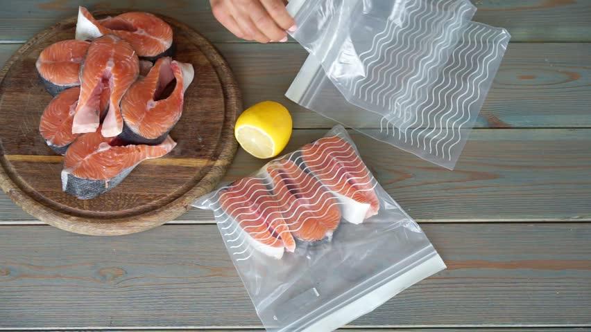 Woman pack salmon steak