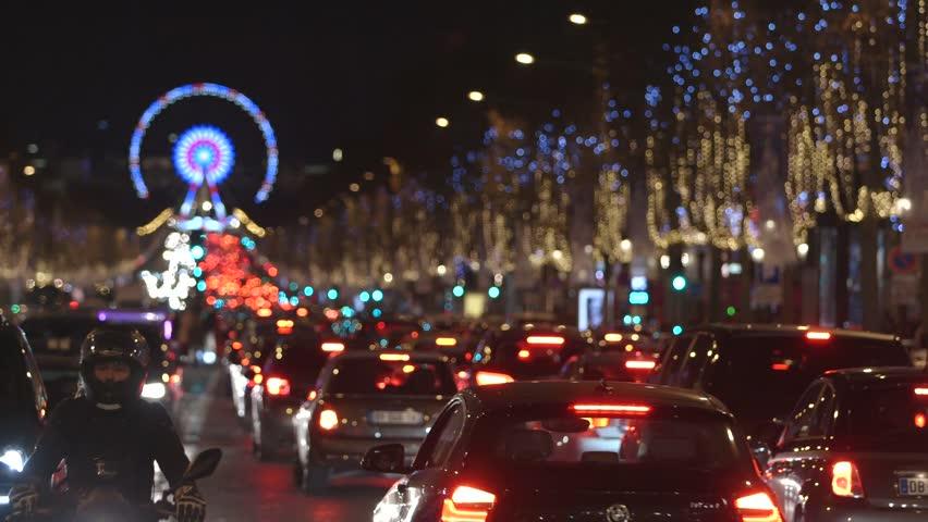 Paris - France - December 2016. Traffic jam on Champs Elysees. Ferris Wheel, Egyptian Obelisk background. Christmas Night light.