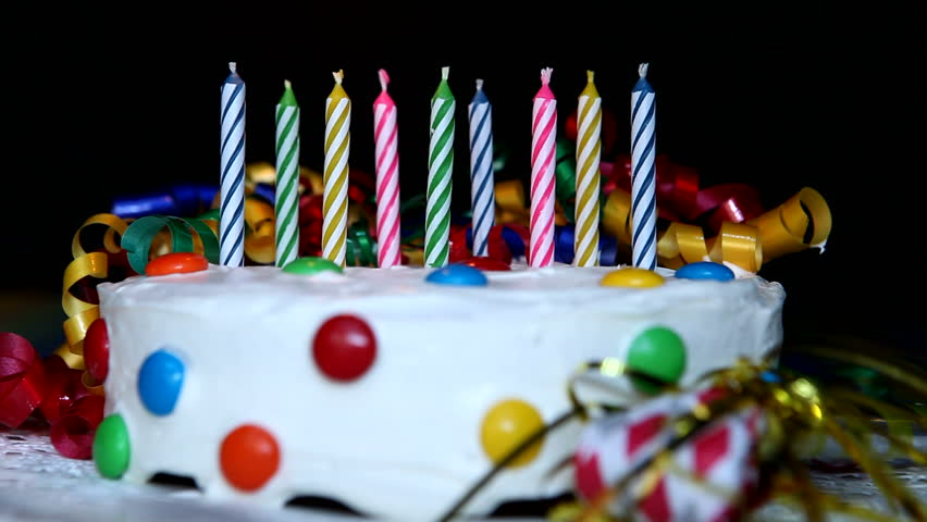 Birthday Candles On Cake Being Lit With A Lighter Stock Footage