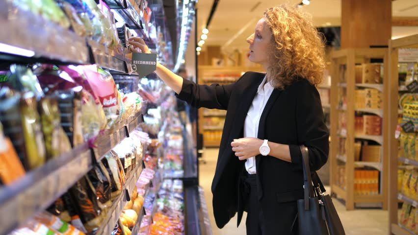 Young Woman Choosing Products In Supermarket. 4K.  | Shutterstock HD Video #30235024
