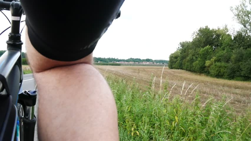 A Cyclist Riding Along a Field. Low Angle. | Shutterstock HD Video #30261304