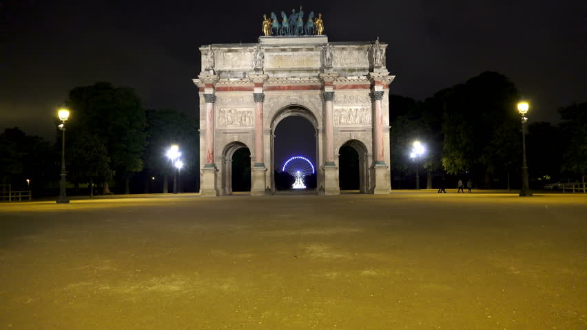 Arc de Triomphe du Carrousel in Paris at  night with view of Eiffel tower lights and Ferris Wheeel at backoorund | Shutterstock HD Video #30271204