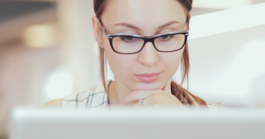 Portrait of Businesswoman Working on Laptop at Co-Working Space, Close Up. 4K SLOW MOTION, DCi. Young business woman, wearing glasses, using portable computer in the modern office building. | Shutterstock HD Video #30286504