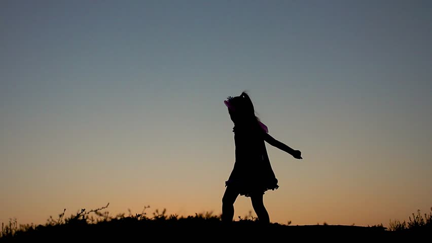 Silhouette of happy little girl dressed in a fairy costume with wings. The child presents himself as a sorceress, the concept of children's play and imagination. | Shutterstock HD Video #30303364