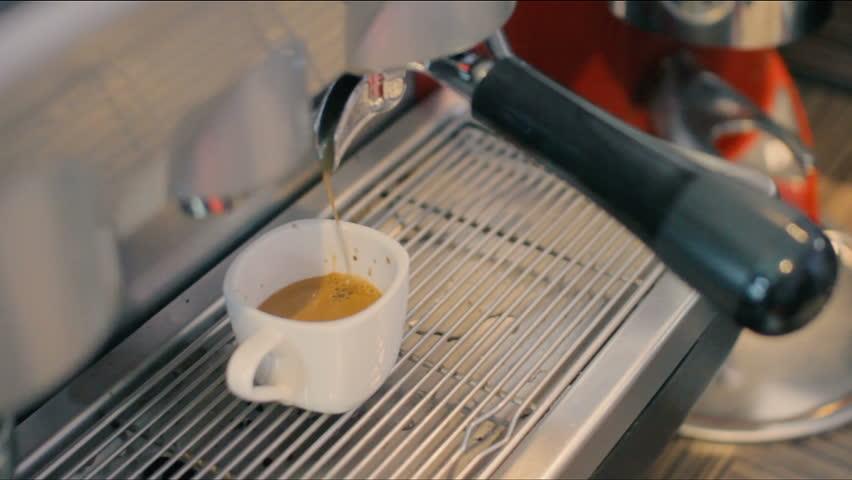 Barista Barrister makes coffees in coffee bar.espresso preparation in coffee machine.Hands bartender cooking coffee, Interior bar, bartender, shallow depth of field