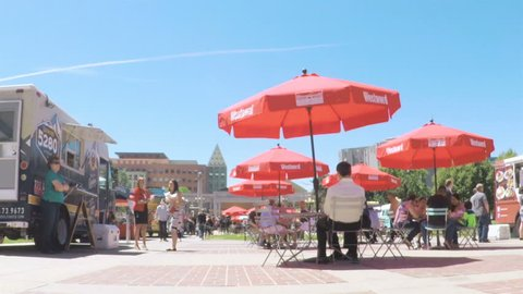 Denver, Colorado, USA-June 15, 2017.  POV point of view - Slow motion. Lunch time gathering of gourmet food trucks at the Civic Center Park.