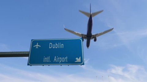 Dublin airport sign airplane passing overhead