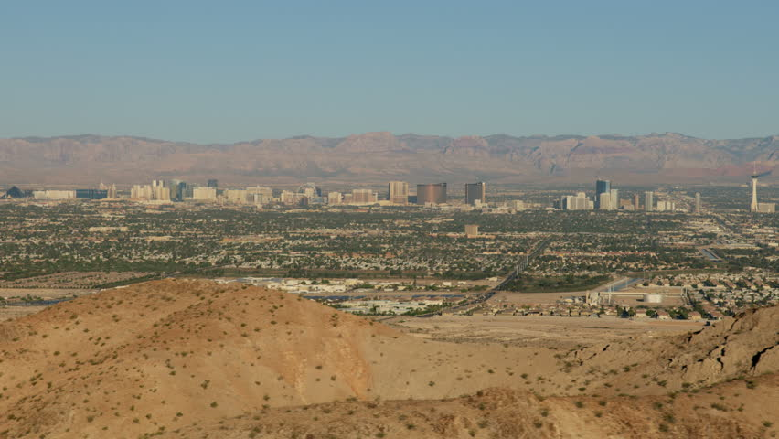 Aerial mountain Cityscape view of Las Vegas city Resort hotels and Casinos a travel and vacation destination Mojave Desert Nevada USA RED WEAPON