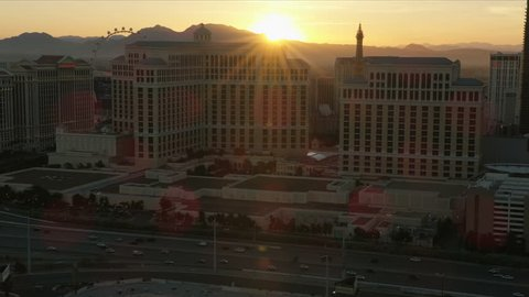 Las Vegas - May 2017: Aerial sun flare view at sunset of Bellagio luxury Resort Hotel and Casino Highway travel destination Nevada USA RED WEAPON