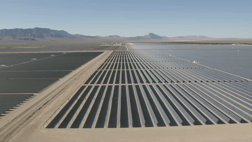 Aerial view Nevada Solar One Photovoltaic Solar units being used to produce natural clean energy for business industrial production Nevada USA RED WEAPON | Shutterstock HD Video #30458194