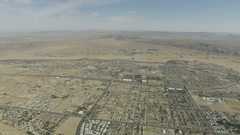 Aerial view of Barstow community a residential city of homes and commercial property community Mojave desert California USA RED WEAPON