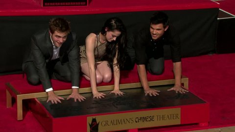 Hollywood, CA - NOVEMBER 03, 2011: Kristen Stewart, Robert Pattinson, Taylor Lautner, poses at the Twilight Cast Hand and Footprint Ceremony held at Grauman's Chinese Theatre