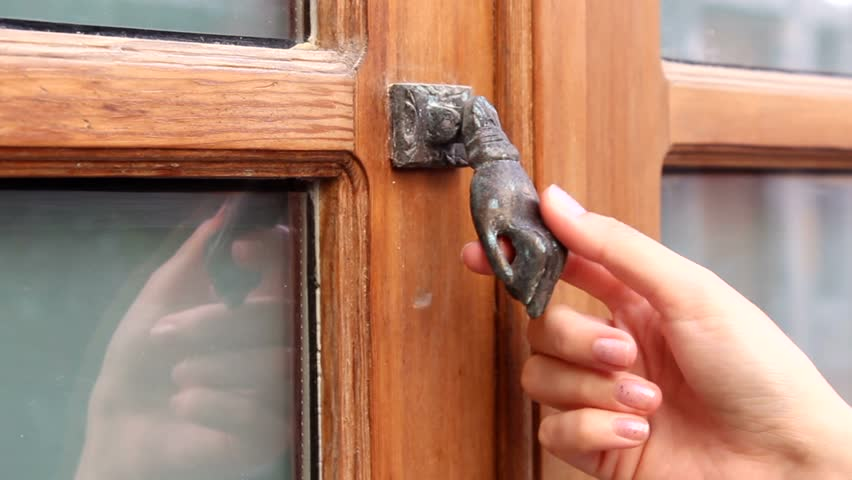 Girl knocks in door with glass parts by small metal hand that used instead of classic & Hand Knocking On Door Stock Footage Video | Shutterstock