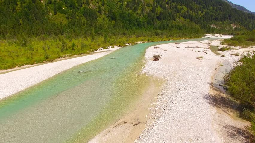 Camera flight over The Isar River that flows to Sylvenstein Lake in Bavarian Alps near Garmisch Partenkirchen. Germany, Central Europe.