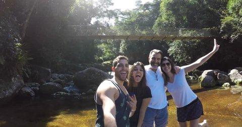 Family taking a selfie on Waterfall on Ilhabela, Sao Paulo, Brazil