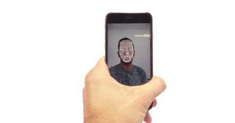Male using the latest mobile phone with facial recognition and secure software. Face ID unlock