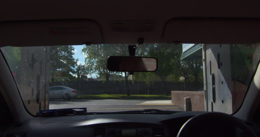 Car wash time-lapse and slow motion. Water jets and soap spray on windscreen