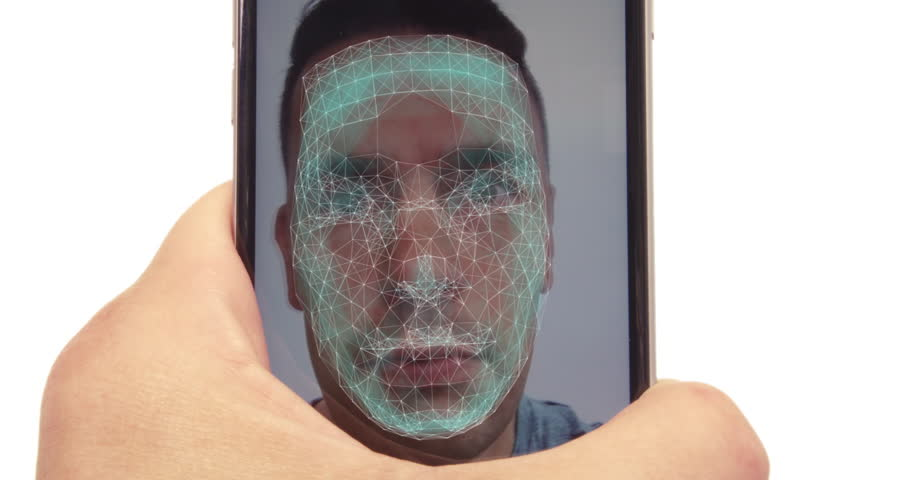 Male using latest smartphone with facial recognition