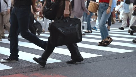 People walking on the crosswalk (Slow Motion Video) Shibuya in Summer It's a slow motion video that people took on crosswalk in Shibuya Tokyo. On the day of summer cloudy.