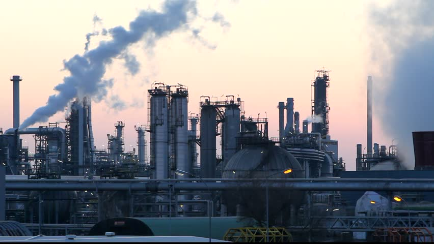 Oil and gas refinery at twilight - factory smoke stack  - Time lapse