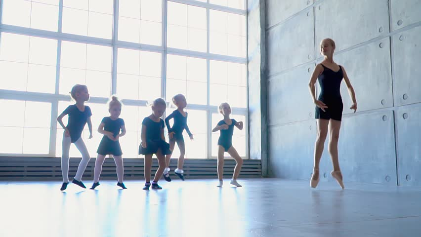 Little girls try to repeat the movements on ballet occupation. Little ballerinas dance in a ballet school with panoramic windows.. | Shutterstock HD Video #30602995