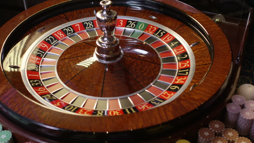 Casino roulette in motion, the spinning wheel ball . With camera motion . Shot on RED EPIC DRAGON Cinema Camera in slow motion. 4K