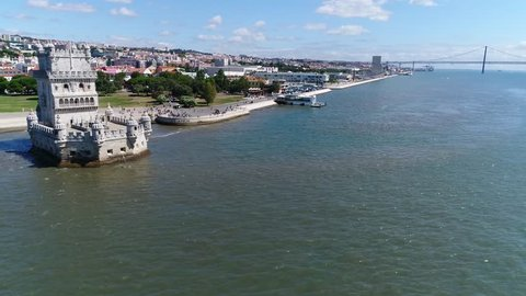Aerial of Belem Tower flying slowy towards the fortified tower located in the civil parish of Santa Maria de Belem in the municipality of Lisbon Portugal it is a UNESCO World Heritage Site 4k quality