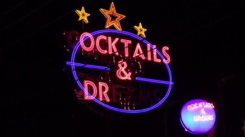 ZAKYNTHOS ISLAND - GREECE, 30 AUGUST, 2017, 4K Cocktails bar advertising sign blink by night, illuminated red led flashing