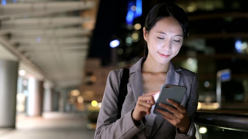 Businesswoman working on cellphone at night  | Shutterstock HD Video #30654112