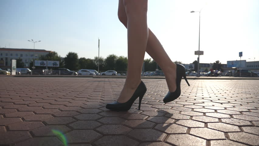 df6a1f3a06b Female legs in high heels shoes walking in the urban street. Feet of young  business woman in high-heeled footwear going in the city. Girl stepping to  work.