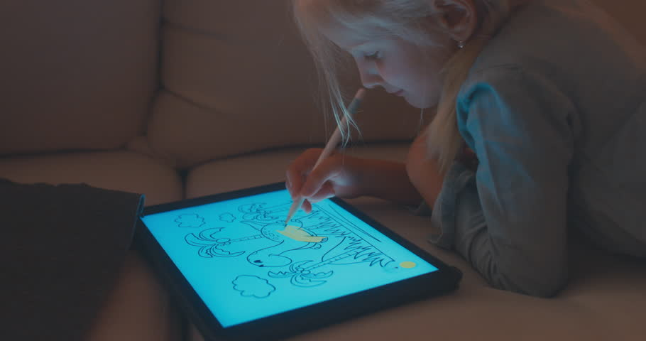CU Cute Caucasian 5 y.o. girl coloring an image on digital tablet using stylus. Modern interior, evening shot. 4K UHD RAW edited footage #30691204
