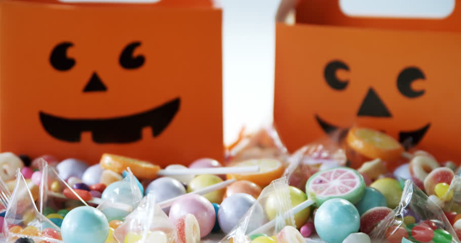 Close-up of halloween box with various candies on white background 4k | Shutterstock HD Video #30694204