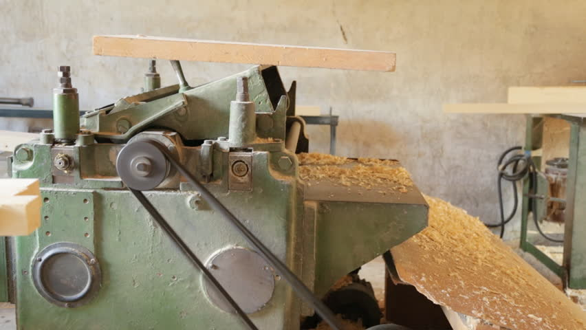 Gouging the wooden square beam on machine | Shutterstock HD Video #30704944