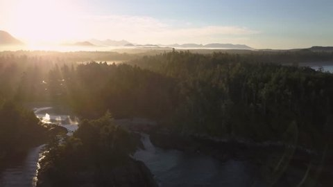 Beautiful aerial natural seascape view of the Pacific Ocean Coast during an bright sunny morning sunrise. Taken in Tofino, Vancouver Island, British Columbia, Canada.