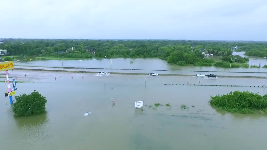 Vehicles driving through flooded i45 in Houston during Hurricane Harvey | Shutterstock HD Video #30723334