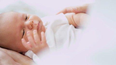 Close Up Parent holding Newborn baby