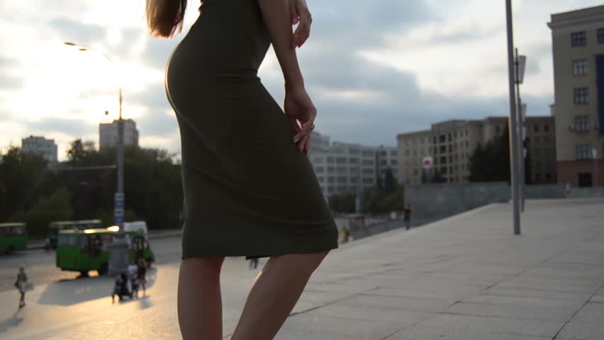 young charming lady in Slinky dress with sexy body stands on the street in the evening #30774514