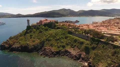 Drone shot of light house, Napoleon Mill House and Forte Stella in Portoferraio, Elba, Italy, summer 2017