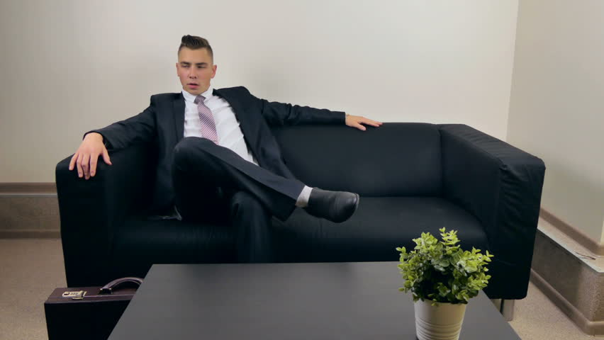 Businessman waiting for a meeting on the couch | Shutterstock HD Video #30788785