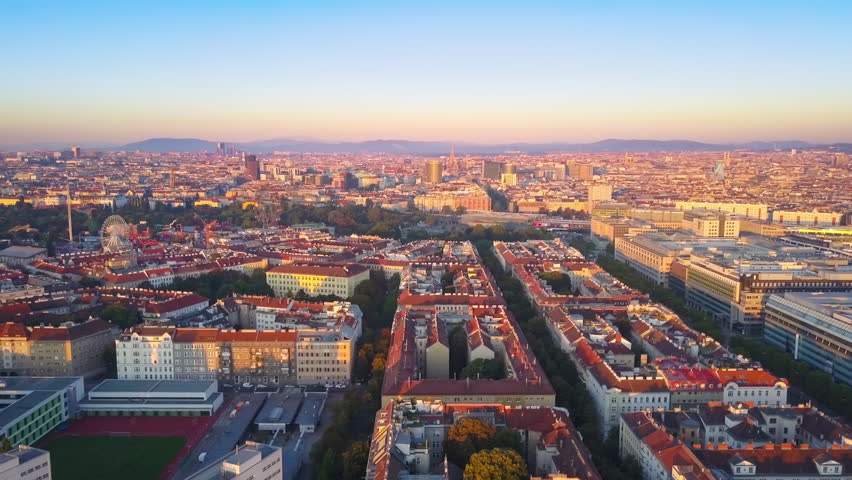 vienna city skyline aerial shot flying sideways at sunrise