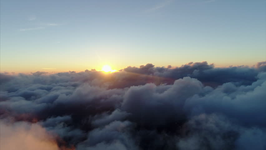 aerial view, flying through clouds at sunset