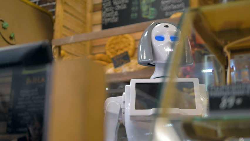 A robot helps customers to shop for bread.