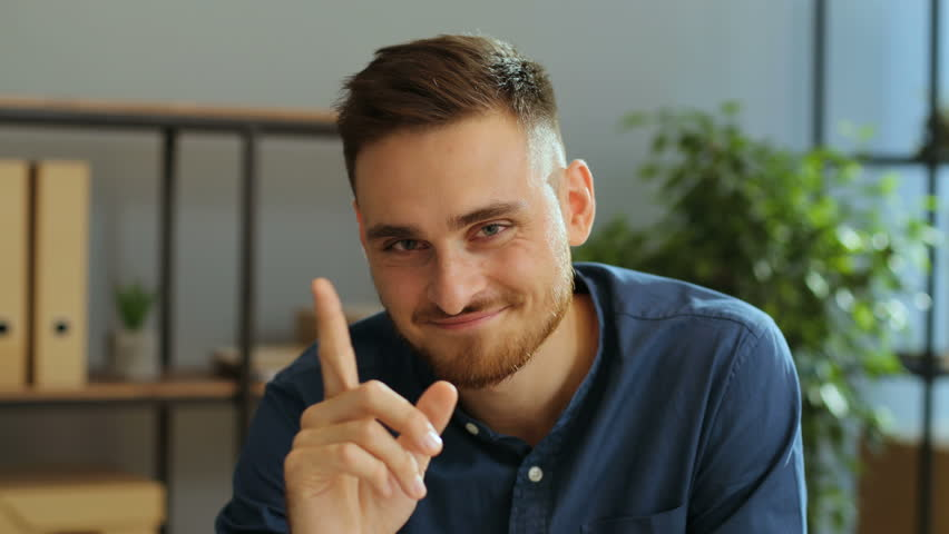 Portrait of emotional funny man moving his fingers at the camera on the grey office background. | Shutterstock HD Video #30873232