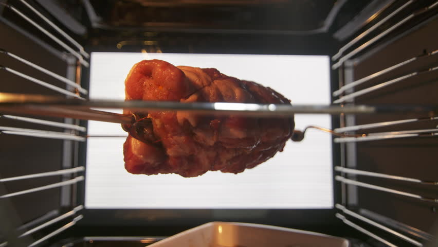Cooking Rotisserie Roast Pork Neck In Hot Convection Oven Closeup Of Raw Meat On
