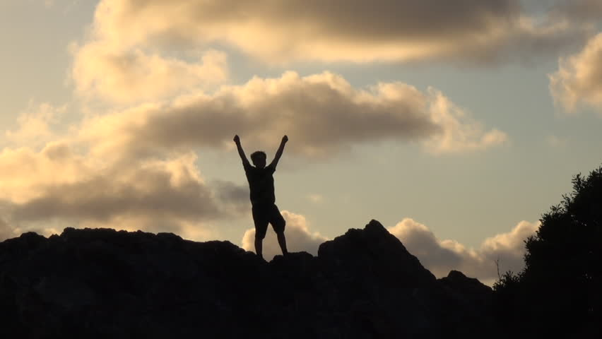 Silhouette of boy with open arms at sunset | Shutterstock HD Video #30888742