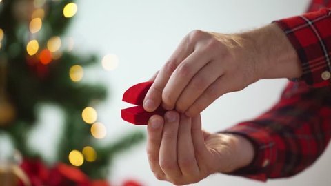 holidays, engagement and proposal concept - hands opening gift box with diamond ring for christmas