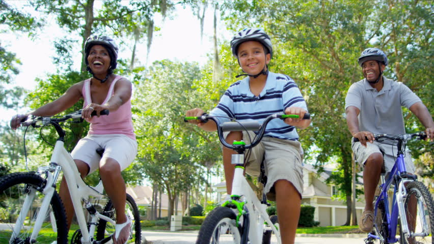 Healthy Fit Ethnic Family Cycling Suburban Roads