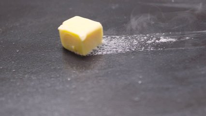 Cube of Butter Melting Sizzling Browning in Non Stick Pan Skillet in Slow Motion, Preparation for Cooking - 50 FPS