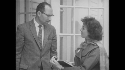 1960s: Woman speaks to resident, referencing her clipboard. Man homeowner talks with her.