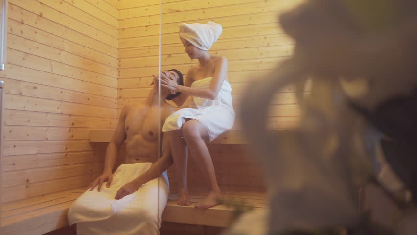 couple spend time in sauna